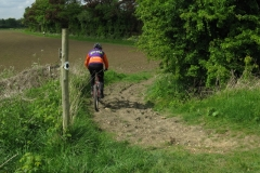 Andy crossing the old railway line near Stanford Hall