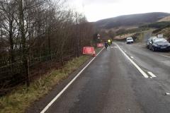 The road was closed beside Torside Reservoir