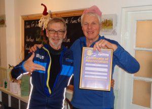 David Cox presenting Mike Thomas with a Cycling UK Appreciation Award at the Christmas Dinner 15-12-2019.