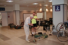 Putting the bikes back together again at Prague airport, Bob had an extra job to do
