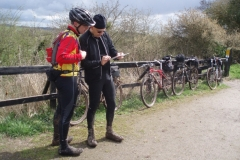 Two visitors checking out the route