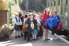 Children re-enacting a wartime evacuation